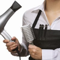 Hairdresser in uniform with working tools
